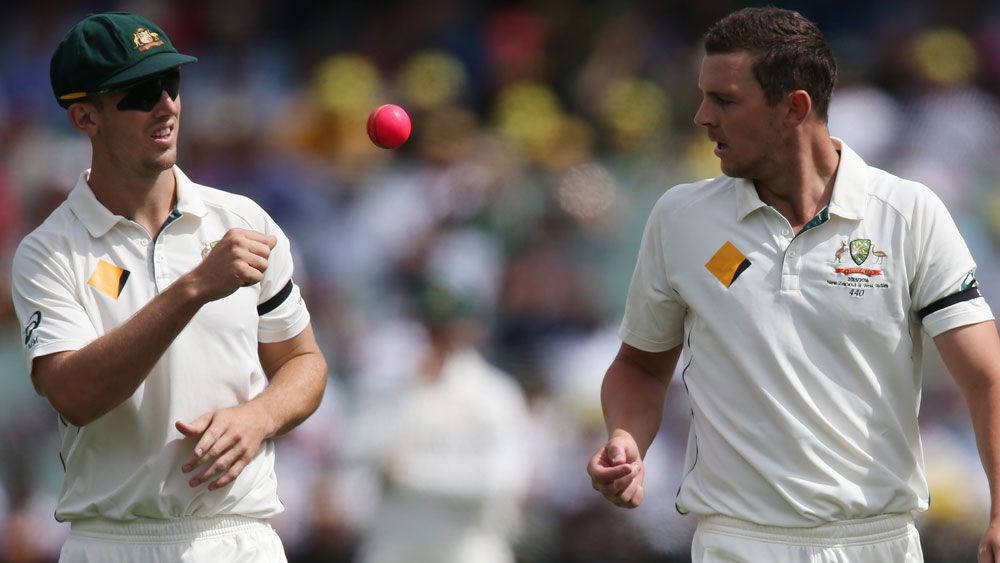 Mitch Marsh tosses the pibk ball to Josh Hazlewood during the Adelaide Test against NewZealand. (AAP)