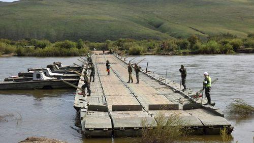 Russian combat engineers build a bridge in eastern Siberia.