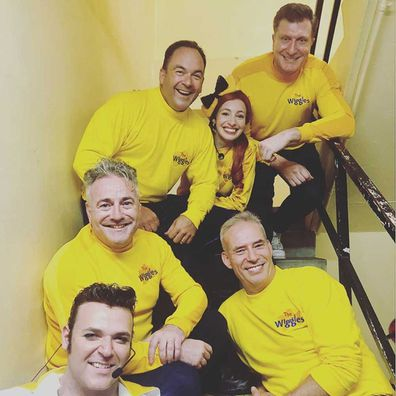 The band wear yellow to honour Greg Page at the second bushfire relief concert in Sydney.
