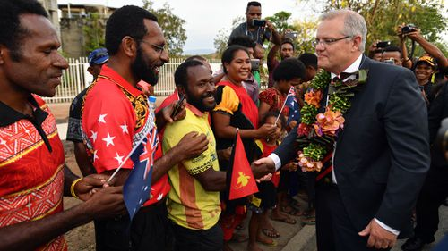Scott Morrison meets locals at the University of Papua New Guinea.