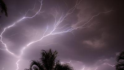 Lighting flickers over Brisbane. (James Dun)