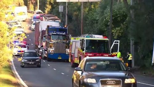 Cyclist and driver in hospital after crash causes peak hour chaos in Sydney
