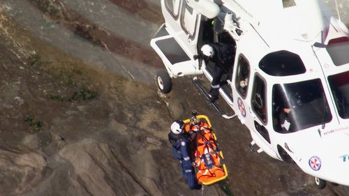 She was winched to safety and airlifted to hospital. Her husband and two grandsons suffered minor injuries.