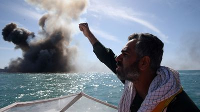 Iran's Revolutionary Guard staged a war game in the Strait of Hormuz, using a mock-up model US warship. (AFP)