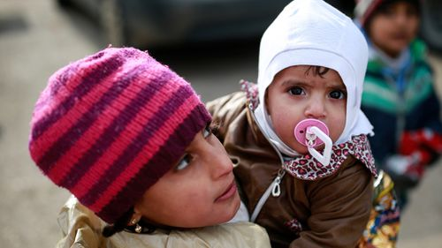 Syrian rivals call for a ceasefire but differ on 'purpose'