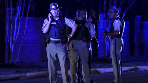 Seven South Carolina law enforcement officers were shot, one fatally, in a confrontation with a suspect who held children hostage in a home and fired on deputies, officials said.