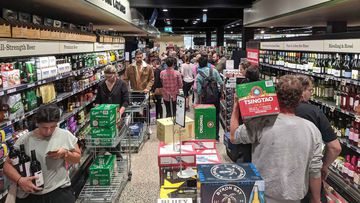 Checkout queues snake down the aisles at a Dan Murphy's in Brunswick late last month.
