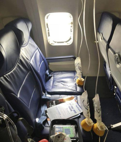 Ms Riordan was partially sucked through the plane's window. (AAP)
