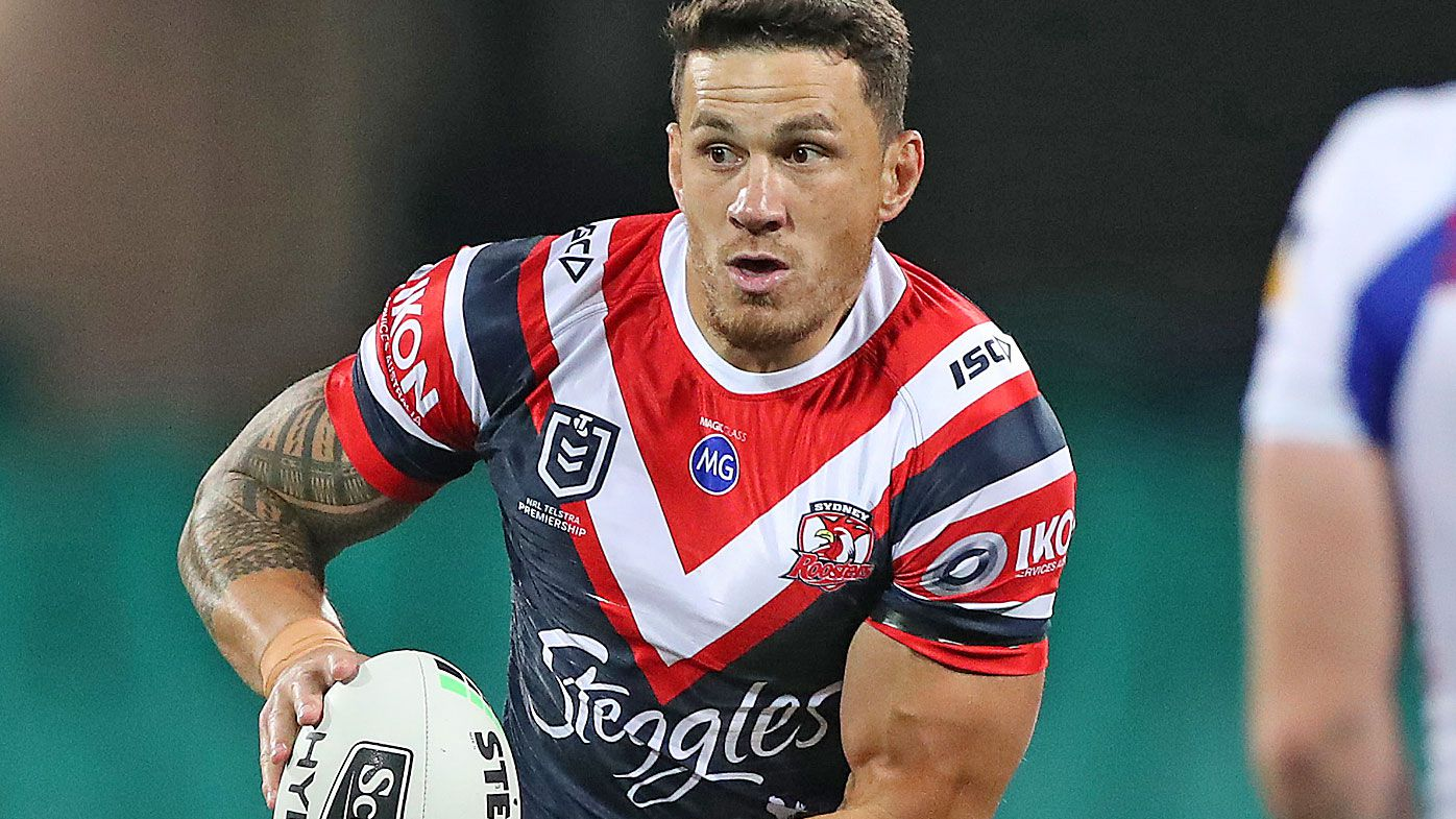 Sonny Bill Williams of the Roosters runs the ball