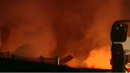 The house was well alight when fire crews arrived. (9NEWS)