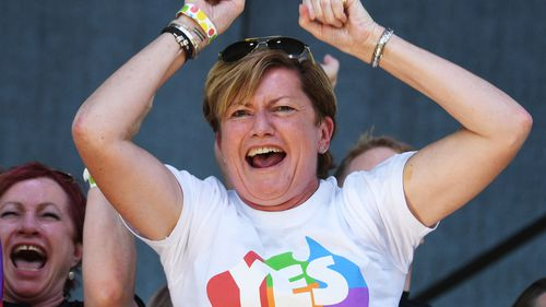 Christine Forster, the sister of former Prime Minister Tony Abbott, celebrates after watching the same sex marriage vote result announcement in Sydney.
