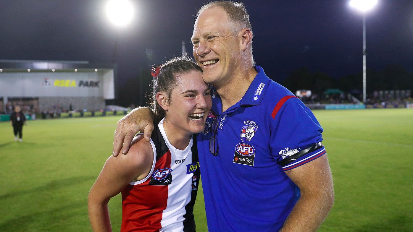 Nathan Burke, Head Coach of the Bulldogs and daughter Alice Burke of the Saints embrace after the 2021 AFLW Round 01 match between the St Kilda Saints and the Western Bulldogs at RSEA Park on January 29, 2021 in Melbourne, Australia.