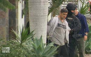 Everton Hills siege ends as man led away in handcuffs after seven hours
