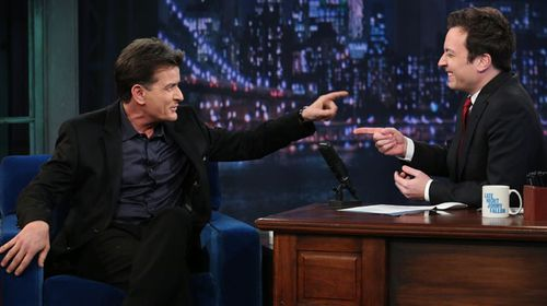 Charlie Sheen talks with chat show host Jimmy Fallon. (Getty)