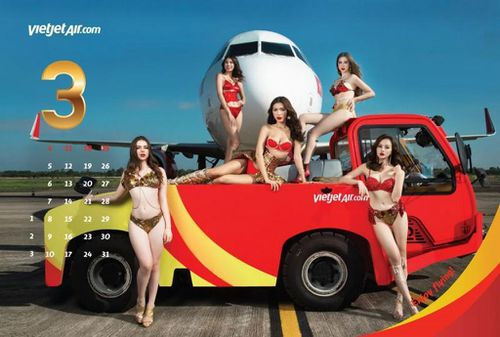 The airline regularly use the sex-appeal of their female staff to sell seats. (VietJet)