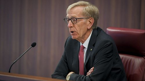 Commissioner Kenneth Hayne watched on as Mr Harris explained how Commonwealth Bank continued to offer him higher credit levels, despite him telling the bank that he didn't want to accept any more. Picture: AAP.