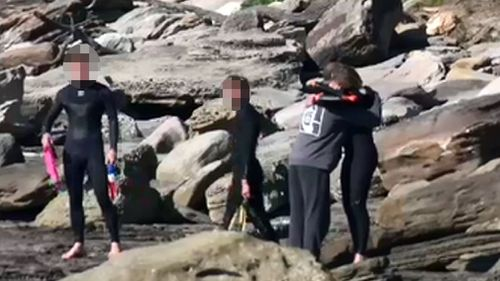 Local surfers came together today to comfort each other following Bob's tragic death.