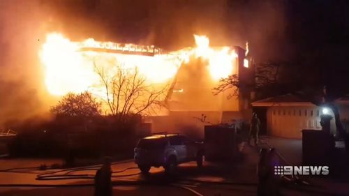 A multi-million dollar mansion in Mullaloo went up in flames last night with 11 people inside.