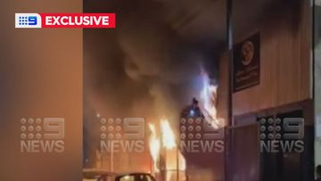Residents jump from burning building