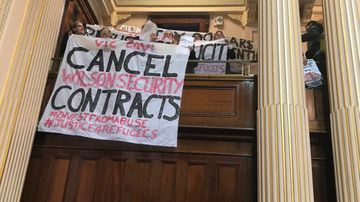 'Cancel Wilson Security': Protesters storm Victorian Parliament