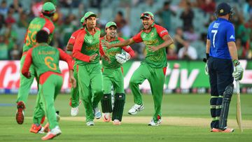Taskin Ahmed and Md. Mahmud Ullah of Bangladesh celebrate after Moeen Ali of England is run out. (Getty)