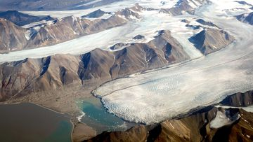 In this view from a passenger plane, melting glaciers are seen during a summer heat wave on Svalbard archipelago on July 28, 2020, near Longyearbyen, Norway.
