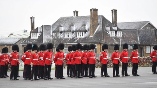 Officers and guardsmen of 1st Battalion the Irish Guards. (PAA/AAP)