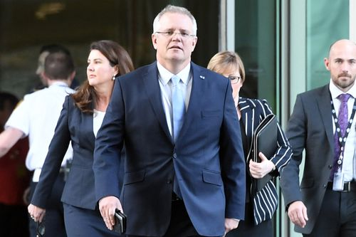 Scott Morrison emerges as Prime Minister from the partyroom meeting.