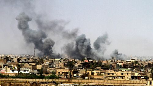 A general view showing smoke clouds rising from the western part of Mosul city, Iraq during a gruelling battle between Iraqi security forces and ISIS.