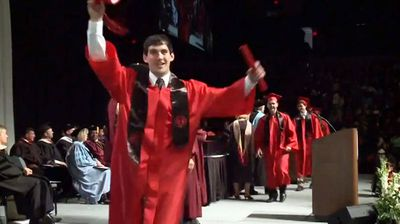 A fist-pumping graduate at Davenport University has failed in his attempt at a celebratory backflip on stage in front of a shocked crowd.