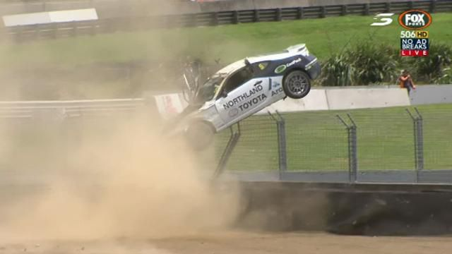 Car rolls three times before climbing fence