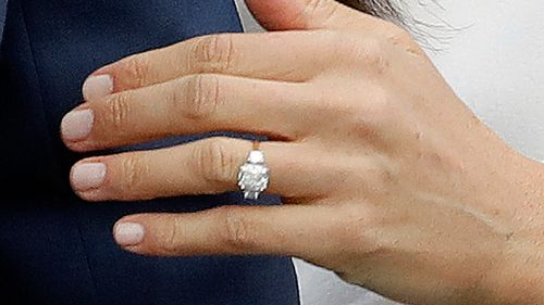 Britain's Prince Harry's fiancee Meghan Markle shows off her engagement ring. (AAP)
