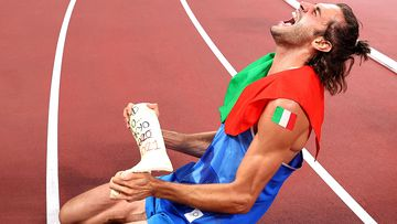 Gold medalist Gianmarco Tamberi of Team Italy celebrates with the cast from the foot he broke just before the 2016 Olympics.