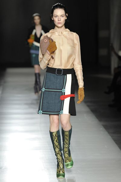 "<p><strong>Classic inspiration:</strong> Prada, Milan Fashion Week on February 24, 2011 </p> <p><strong>Buy:</strong> Prada green runway boot, Spring 2011, approx. $434.05 at <a href=""https://www.vestiairecollective.com/women-shoes/boots/prada/green-suede-prada-boots-4832805.shtml"" target=""_blank"" draggable=""false"">Vestiaire Collective</a></p>"