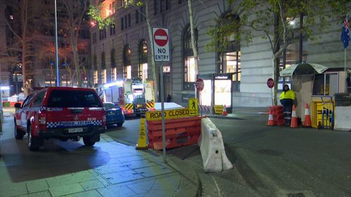 Firefighters rushed to salvage the building while police closed George Street outside. Picture: 9NEWS.