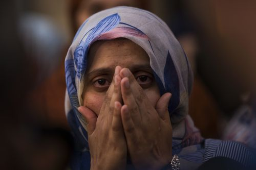 A woman weeps during a gathering of members of the local Muslim community along with relatives of young men believed responsible for the attacks in Barcelona and Cambrils to denounce terrorism and show their grief in Ripoll, north of Barcelona. (AP)