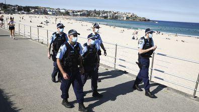 Police check people at Bondi Beach. Sydney