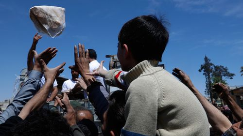 People get supplies in Douma. (AP/AAP)