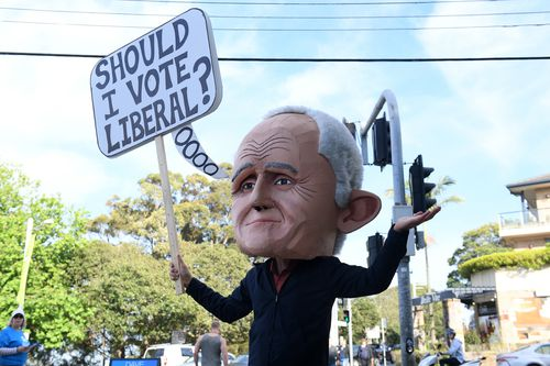 A protester dressed as former prime minister Malcolm Turnbull is seen at a polling place at Bellevue Hill, Sydney.