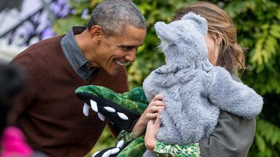 Mr Obama meets a young, furry fan. (AAP)