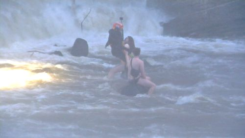 The couple were trapped in the Abbottsford reserve and needed to be rescued by a helicopter.