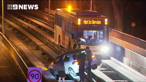 An Adelaide driver caused early morning commuter chaos after crashing his car onto the tracks of the city's O-Bahn busway.