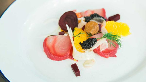 Beetroot cured kingfish with citrus and fennel salad, avruga roe and horseradish cream. Photography: Minhky Le