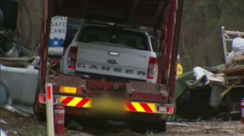 A car-carrier truck and another pantech truck collided before a small fire ignited and one of the drivers died at the scene.