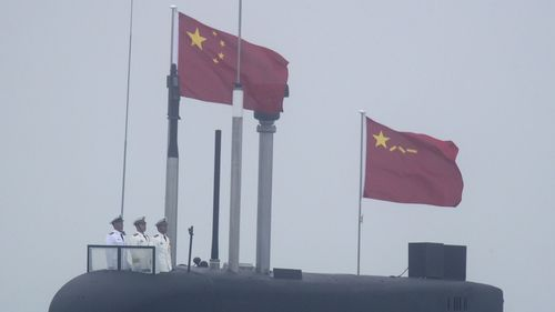 China's navy and air force took part in military drills close to Taiwan in a provocative act.