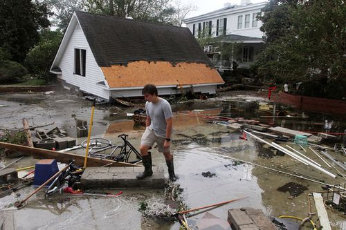 A resident looks at flood debris and storm damage from Hurricane Florence at a home on East Front Street in New Bern, North Carolina.