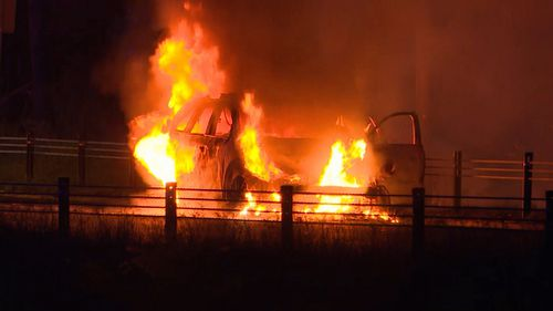 The officers pulled the car over and escaped the vehicle just as flames emerged from beneath the Sorrento's hood, NSW Police reports. (9NEWS)