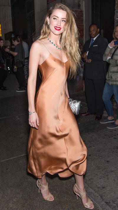 <p>Wearing a slip dress by The Row.</p>