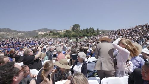 A pelican flew into the crowd, landing among the seated audience. (YouTube: Grant Dillion)
