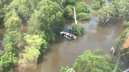 NT cop rescued from roof of car after being swept away by floodwaters